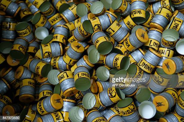 Screw caps for bottles of 'Liminana' company that manufactures Pastis are pictured at the company's plant in Marseille southern France on September 6...