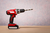 Screwdriver, Cordless Drill on wood table