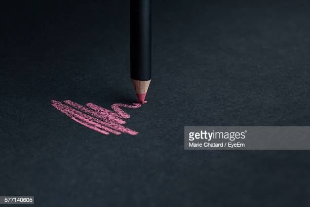 Scribble Of Pink Pencil On Black Paper