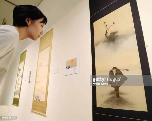A scroll piece featuring manga character Black Jack created by the artist Osamu Tezuka and three crows drawn by Rimpastyle artist Suzuki Kiitsu is on...