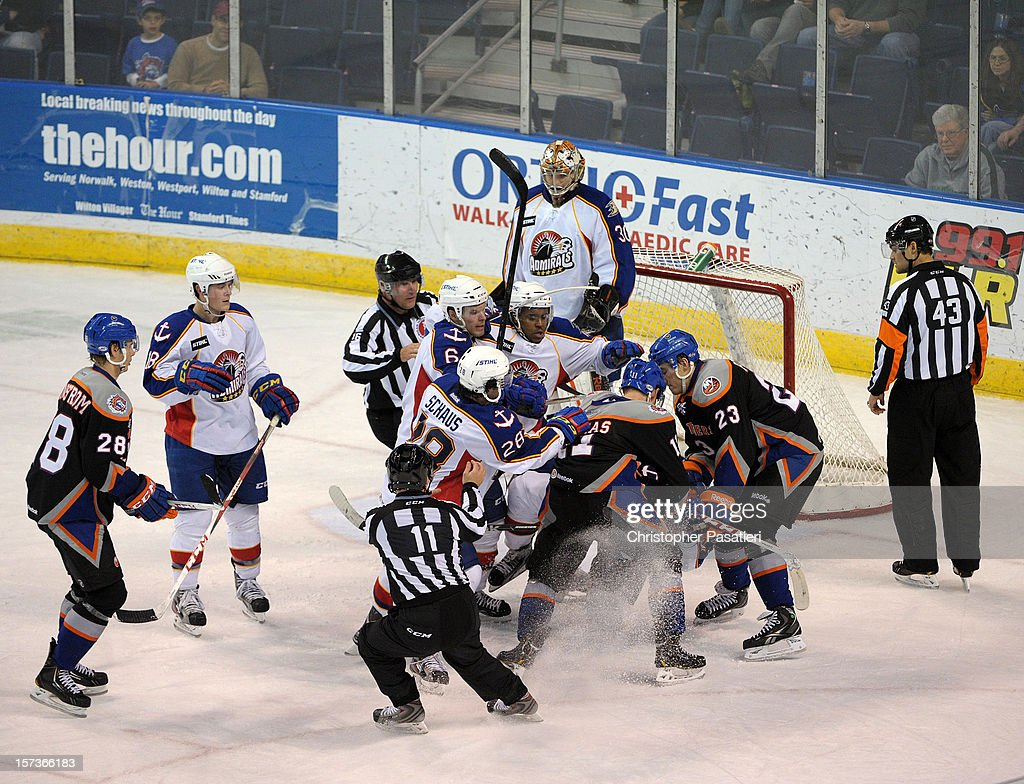 A scrum ensues after a whistle between the Norfolk Admirals and Bridgeport Sound Tigers during an American Hockey League game on December 2, 2012 at the Webster Bank Arena in Bridgeport, Connecticut. The Admirals defeated the Sound Tigers 4-1.