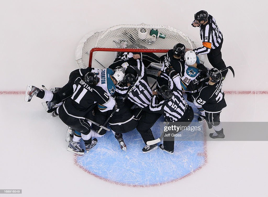 A scrum ensues between the San Jose Sharks and the Los Angeles Kings in the third period of Game Two of the Western Conference Semifinals during the 2013 NHL Stanley Cup Playoffs at Staples Center on May 16, 2013 in Los Angeles, California. The Kings defeated the Sharks 4-3.
