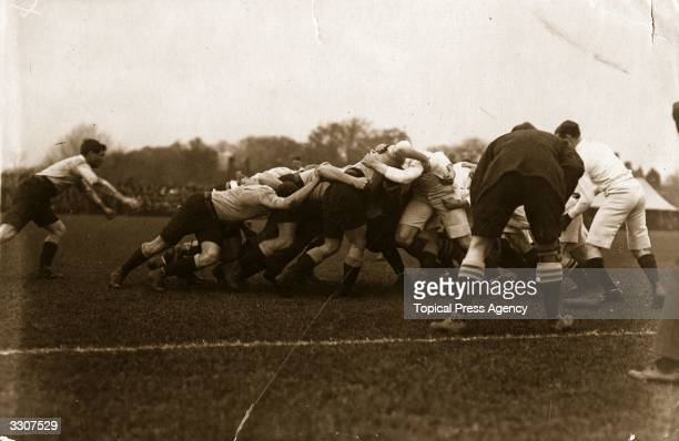 A scrum in a rugby match between Cambridge and Australia