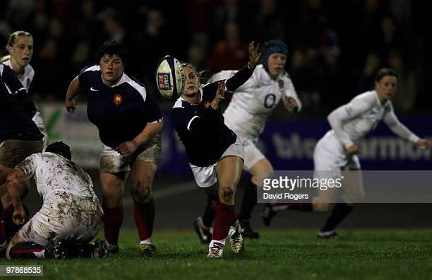Scrumhalf Marie Alice Yahe of France passes the ball away from a ruck during the Women's Six Nations match between France and England at the Stade...