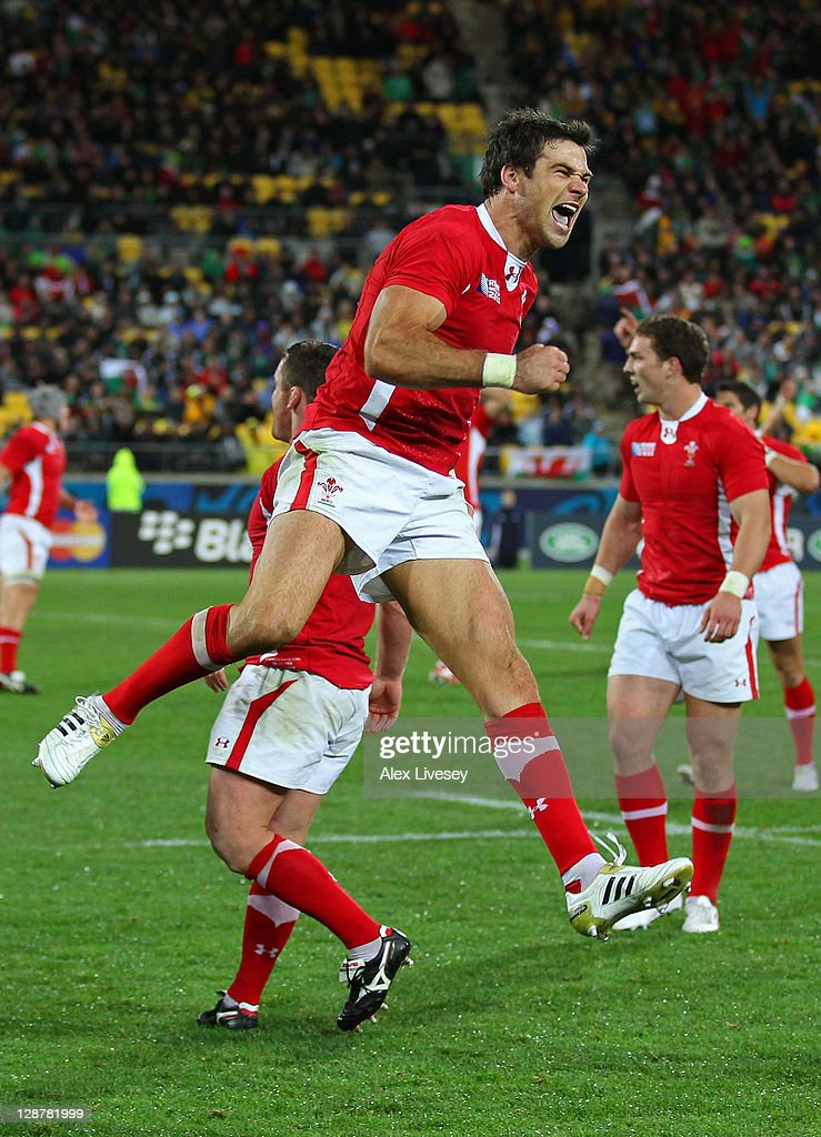 Scrumhalf Mike Phillips of Wales celebrates his team's 22-10 victory as the final whistle blows during quarter final one of the 2011 IRB Rugby World Cup between Ireland v Wales at Wellington Regional Stadium on October 8, 2011 in Wellington, New Zealand.