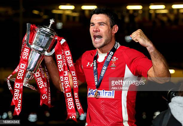 Scrumhalf Mike Phillips of Wales celebrates with the Six Nations Trophy following his team's victory during the RBS Six Nations match between Wales...