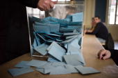 A scrutineer empties a ballot box prior to count the votes at a polling station on March 21 2010 in Vesoul eastern France during the second round of...