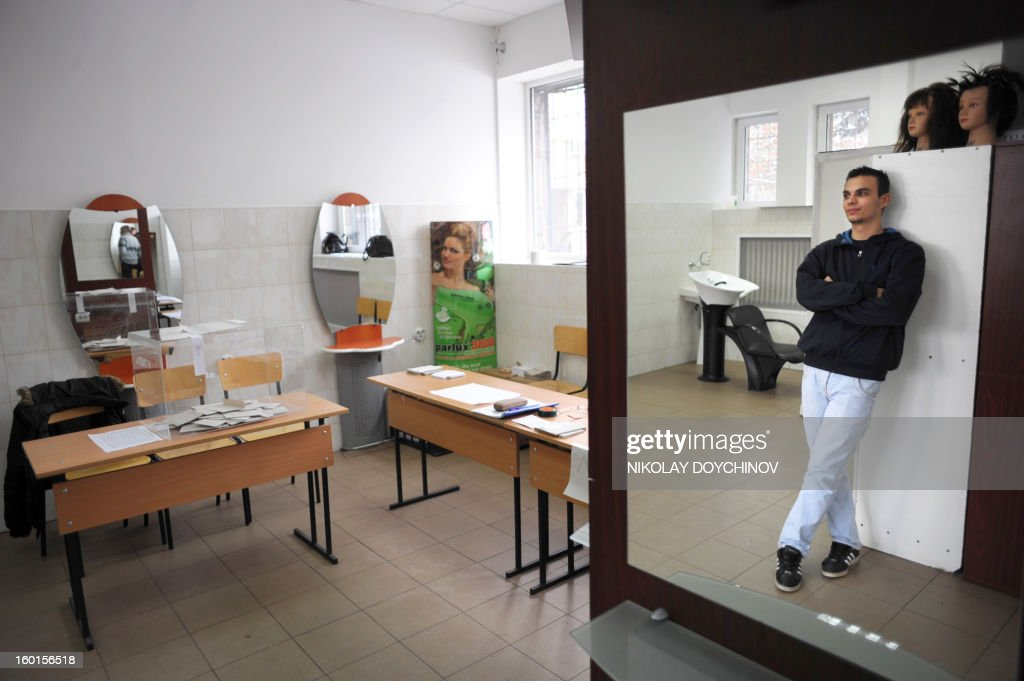 A scrutineer waits in a hairdresser salon turned into a polling station which is empty during the national referendum in Sofia on January 27, 2013. Bulgarians voted Sunday on whether to revive plans ditched by the government to construct a second nuclear power plant, in the EU member's first referendum since communism. The referendum asks 6.9 million eligible voters: 'Should Bulgaria develop nuclear energy by constructing a new nuclear power plant ?'. AFP PHOTO / NIKOLAY DOYCHINOV