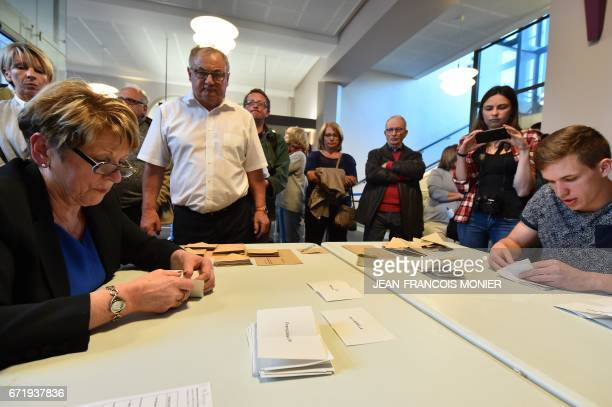 Scrutineers count votes at the end of the first round of the French presidential election first round on April 23 2017 in SablesurSarthe northwestern...
