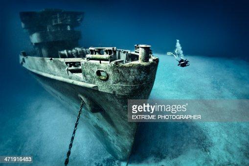Scuba diver exploring ship wreck