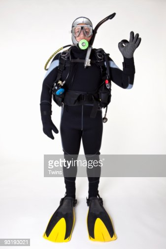 A scuba diver giving the OK sign, studio shot
