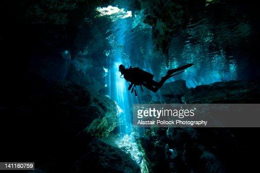 Scuba diver inside cenote in Mexico