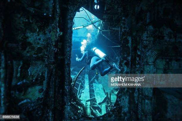 A scuba diver is seen at the wreck of a ship in the Red Sea off the southern Israeli resort city of Eilat on June 12 2017 Global warming has in...