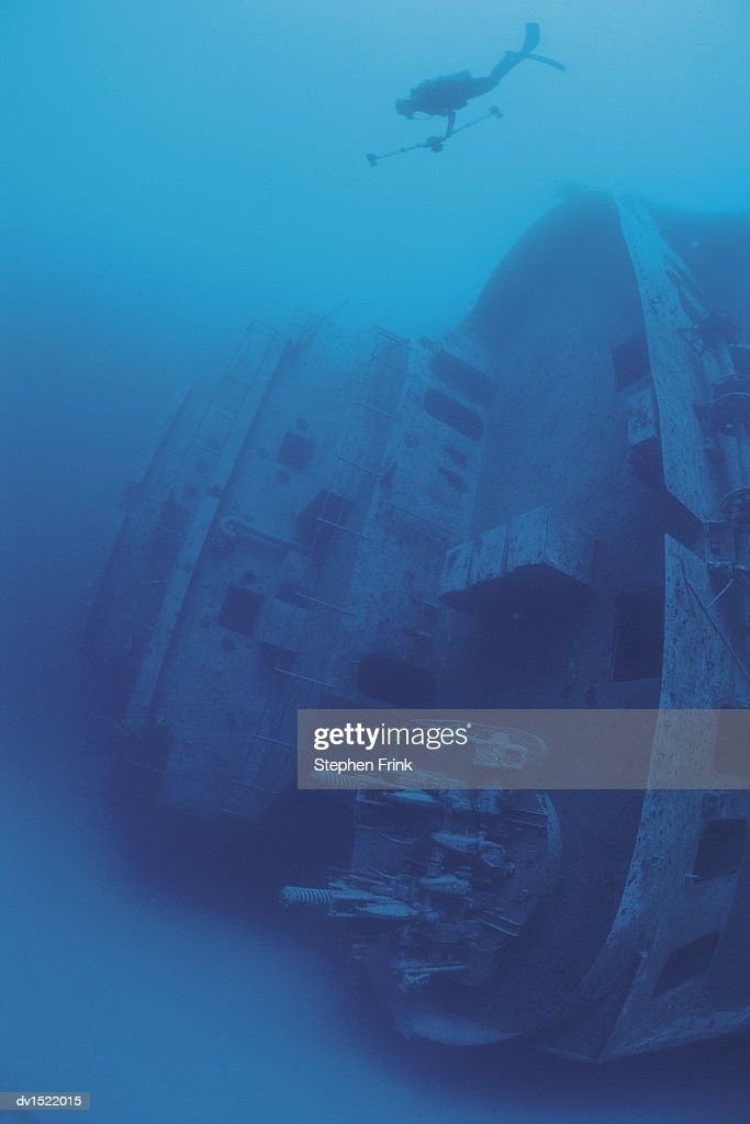 Scuba Diver Moving Towards Shipwreck on Seabed, Bermuda