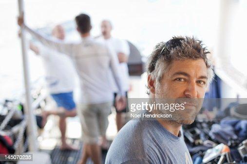 A scuba diver on a live aboard deck after a dive