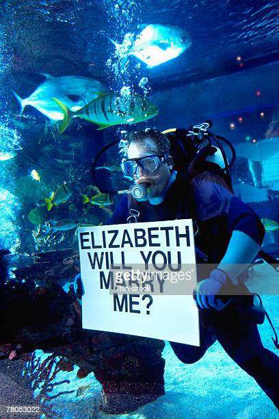 Scuba diver proposing marriage