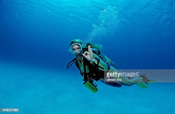 Scuba diver shows oK signal Netherlands Antilles Bonaire Caribbean Sea