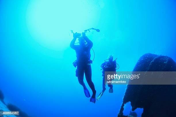 Scuba Diver Silhouette over a shipwreck