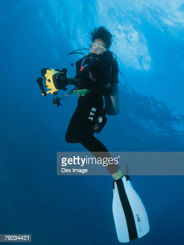 Scuba diver underwater, portrait : Stock Photo