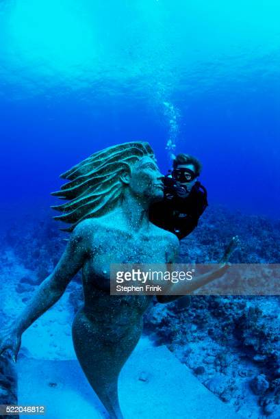 Scuba Diver with Mermaid Statue