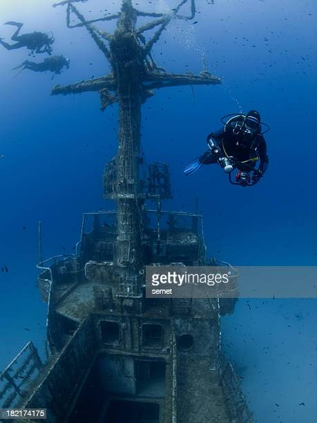 scuba divers on a ship wreck