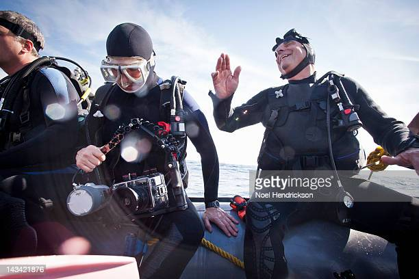 Scuba divers on an inflatable boat