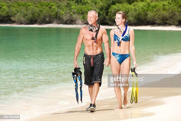 Scuba Diving: Couple Walking on Beach