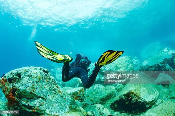 Scuba diving    Underwater  scuba diver in blue lagoon