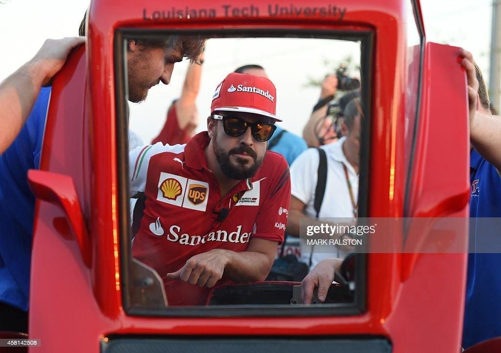 Scuderia Ferrari driver Fernando Alonso of Spain prepares to race teammate Kimi Raikkonen of Finland in their Shell EcoMarathon cars during preview...