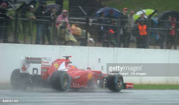 Scuderia Ferrari driver Fernando Alonso skids off the track on his way to taking pole position during qualifying for the British Grand Prix at...