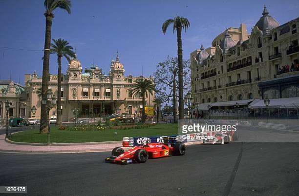 Scuderia Ferrari driver Gerhard Berger of Austria holds off McLaren Honda driver Alain Prost of France as they race through Casino Square during the...