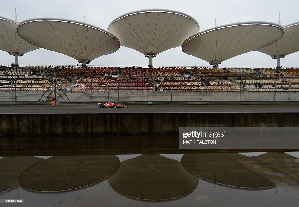 Scuderia Ferrari driver Kimi Raikkonen of Finland drives on the back straight during the third practice session of the Formula One Chinese Grand Prix in Shanghai on April 19, 2014. AFP PHOTO/Mark RALSTON