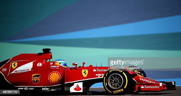 Scuderia Ferrari Spanish driver Fernando Alonso steers his car during the third practice session of the Formula One Bahrain Grand Prix at Bahrain's...