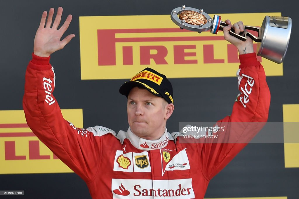 Scuderia Ferrari's Finnish driver Kimi Raikkonen celebrates his third place after the Formula One Russian Grand Prix at the Sochi Autodrom circuit on May 1, 2016. / AFP / YURI