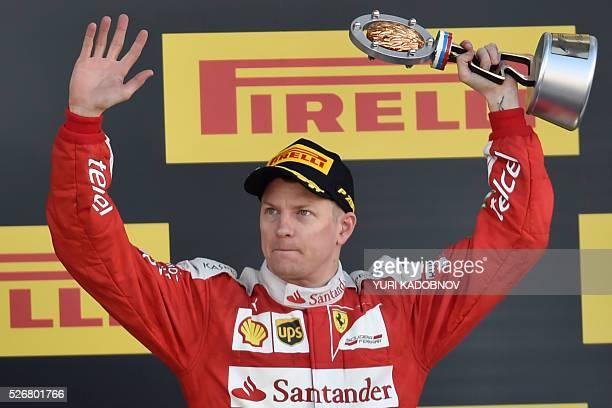 Scuderia Ferrari's Finnish driver Kimi Raikkonen celebrates his third place after the Formula One Russian Grand Prix at the Sochi Autodrom circuit on...