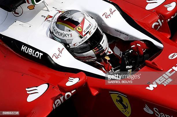 Scuderia Ferrari's German driver Sebastian Vettel drives during the second practice session at the Autodromo Nazionale circuit in Monza on September...