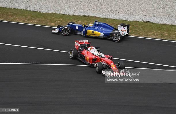 TOPSHOT Scuderia Ferrari's German driver Sebastian Vettel rejoins the track after slipping off the track whilst Sauber F1 Team's Swedish driver...