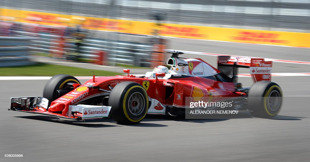 Scuderia Ferrari's German driver Sebastian Vettel steers his car during the second practice session of the Formula One Russian Grand Prix at the Sochi Autodrom circuit on April 29, 2016. / AFP / ALEXANDER