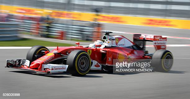 Scuderia Ferrari's German driver Sebastian Vettel steers his car during the second practice session of the Formula One Russian Grand Prix at the...