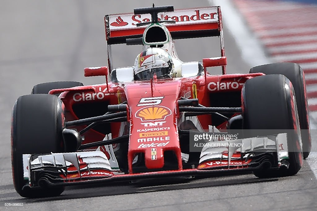 Scuderia Ferrari's German driver Sebastian Vettel steers his car during the qualifying session of the Formula One Russian Grand Prix at the Sochi Autodrom circuit on April 30, 2016. / AFP / ALEXANDER
