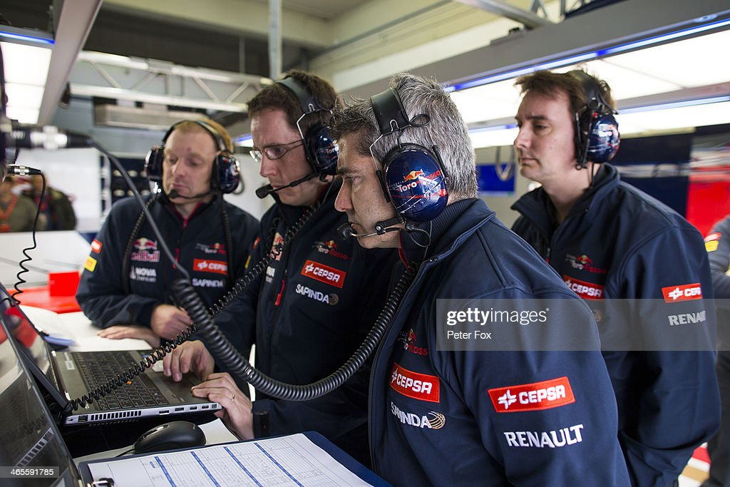 Scuderia Toro Rosso engineers study the lap times during day one of Formula One Winter Testing at the Circuito de Jerez on January 28, 2014 in Jerez de la Frontera, Spain.