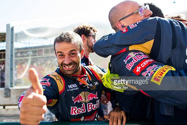 Scuderia Toro Rosso mechanics celebrate 4th place during the Formula One Grand Prix of Hungary at Hungaroring on July 26 2015 in Budapest Hungary