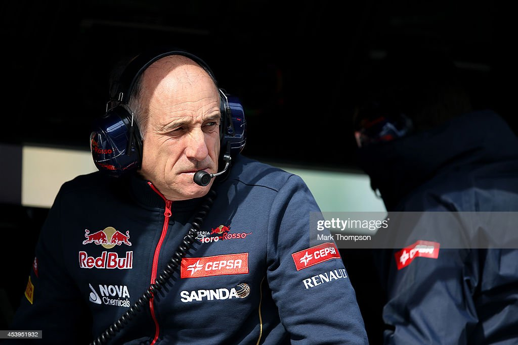 Scuderia Toro Rosso Team Principal Franz Tost looks on from the pit wall during practice ahead of the Belgian Grand Prix at Circuit de Spa-Francorchamps on August 22, 2014 in Spa, Belgium.