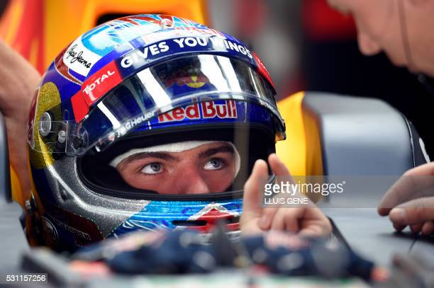 Scuderia Toro Rosso's BelgianDutch driver Max Verstappen gestures as he sits in his car during the first practice session at the Circuit de Catalunya...