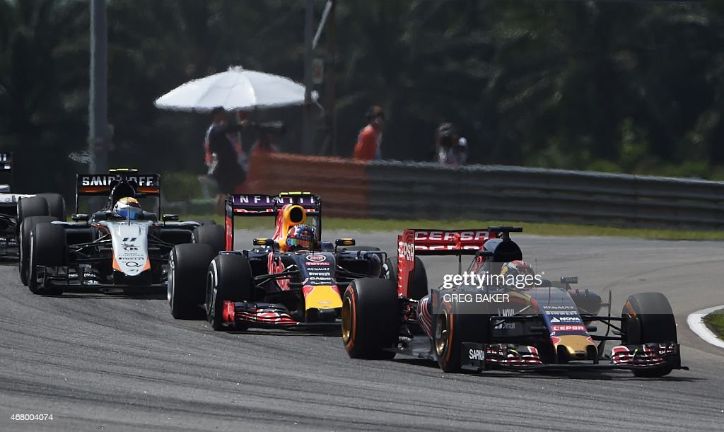 Scuderia Toro Rosso's Dutch driver <a gi-track='captionPersonalityLinkClicked' href=/galleries/search?phrase=Max+Verstappen&family=editorial&specificpeople=12813205 ng-click='$event.stopPropagation()'>Max Verstappen</a> (R) takes a corner ahead of Infiniti Red Bull Racing's Russian driver <a gi-track='captionPersonalityLinkClicked' href=/galleries/search?phrase=Daniil+Kvyat&family=editorial&specificpeople=10936016 ng-click='$event.stopPropagation()'>Daniil Kvyat</a> (C) and Sahara Force India F1 Team's Mexican driver Sergio Perez (L) during the Formula One Malaysian Grand Prix in Sepang on March 29, 2015. AFP PHOTO / Greg BAKER