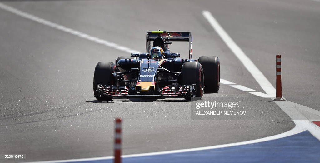 Scuderia Toro Rosso's Spanish driver Carlos Sainz Jr steers his car during the second practice session of the Formula One Russian Grand Prix at the Sochi Autodrom circuit on April 29, 2016. / AFP / ALEXANDER