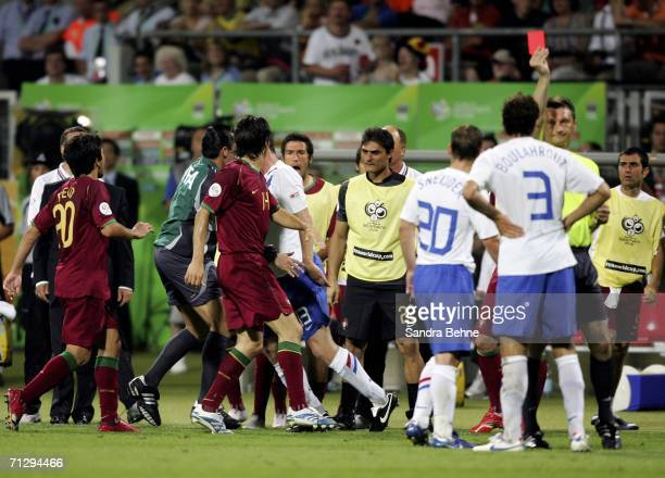 A scuffle breaks out as Khalid Boulahrouz of the Netherlands is shown the red card by Referee Valentin Ivanov of Russia after appearing to elbow Luis...