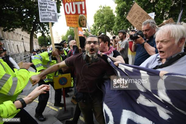 A scuffle breaks out as protesters attend a rally calling for justice for those affected by the Grenfell Tower fire outside Downing Street on June 16...