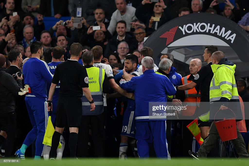 A scuffle breaks out as the players walk off the pitch following the 2-2 draw during the Barclays Premier League match between Chelsea and Tottenham Hotspur at Stamford Bridge on May 02, 2016 in London, England.jd