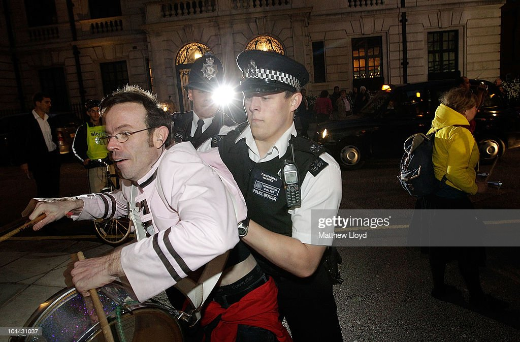 Scuffles break out between police and protestors demonstrating against British Telecom outside the entrance to the British Olympic Ball at Grosvener House hotel on September 24, 2010 in London, England. Over 60 Olympic medallists joined an audience of over 1100 to raise funds for Team GB ahead of the London 2012 Olympic Games.